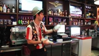 Flairing. Barman juggles bottles. Professional skill