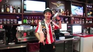Flairing. Barman juggles bottles