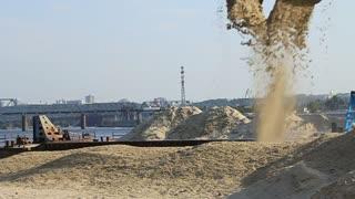 Floating crane unloading sand