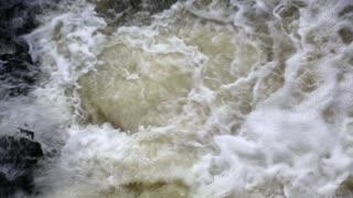 Foamy water of a waterfall