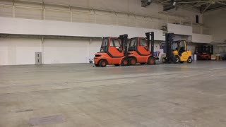 Forklift loaders inside the warehouse