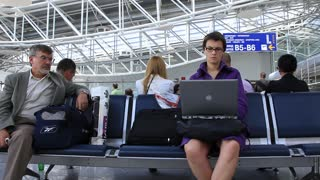 Girl in airport with notebook