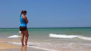 Girl looks on sea