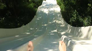 Going down a slide in a waterpark. A man go down a water slide in big aquapark in Antalya, Turkey