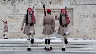 GREECE, ATHENS, JUNE 7, 2013: Greek national guards (Evzones) in front of the Tomb of the Unknown Soldier near building of Parliament. Changing of the Guard, Athens, Greece, June 7, 2013
