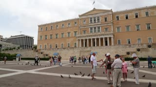 GREECE, ATHENS, JUNE 7, 2013: People and pigeons near Parliament and Syntagma Square in Athens, Greece