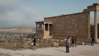 GREECE, ATHENS, JUNE 7, 2013: People near Erechtheion or Erechtheum - is an ancient Greek temple in Acropolis of Athens in Greece which was dedicated to both Athena and Poseidon