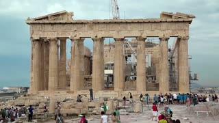 GREECE, ATHENS, JUNE 7, 2013: People near Parthenon - ancient temple in Athenian Acropolis, Greece, June 7, 2013