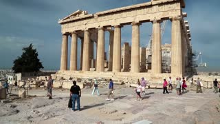 GREECE, ATHENS, JUNE 7, 2013: People near Parthenon - ancient temple in Athenian Acropolis, Greece