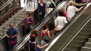 GREECE, ATHENS, JUNE 7, 2013: People on escalator in underground station in Athens, Greece, June 7, 2013