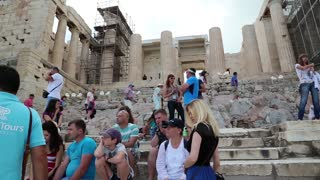 GREECE, ATHENS, JUNE 7, 2013: Tourists in Athenian Acropolis in Greece