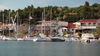 GREECE, NEA SKIONI, KASSANDRA PENINSULA, CHALKIDIKI, JUNE 3, 2013: Yachts in harbour in Nea Skioni village in Greece