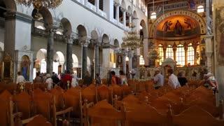 GREECE, THESSALONIKI, JUNE 10, 2013: People inside Church of Saint Demetrius, or Hagios Demetrios, is the main sanctuary dedicated to Saint Demetrius, the patron saint of Thessaloniki, Greece
