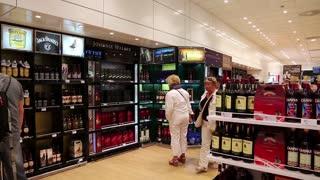 GREECE, THESSALONIKI, JUNE 12, 2013: People inside duty free store in international airport in Thessaloniki, Greece.