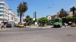 Green tram rides on the street in Tunis, Tunisia
