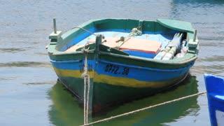 Green wooden boat afloat