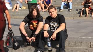 Heavy metal fan sit on stairs