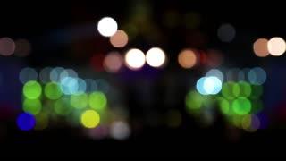 Holiday concert. Defocused lights of projectors