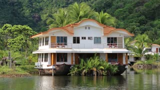 Houseboat amongst palms on the Koh-Chang island in Thailand