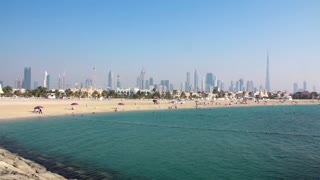 Jumeira Beach, named after the Jumeirah district of Dubai, is a stretch of beach ten miles south of Dubai where developers are creating large hotel resorts and luxury housing. Also built here is the Burj Al Arab (Arab Tower) hotel