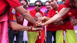 "KIEV, UKRAINE - 1 JULY 2012: Spanish football fans in red shirts before final match of European Football Championship ""EURO 2012"" (Spain vs Italy), Kiev, Ukraine, July 1, 2012."