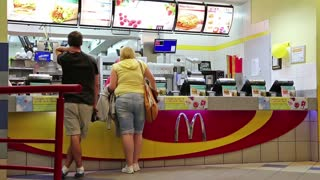 KIEV, UKRAINE, AUGUST 12, 2012: The opening of the new restaurant McDonalds and distribution of free hot drinks, August 12, 2012 in Kiev, Ukraine.