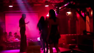 KIEV, UKRAINE, AUGUST 12, 2012: Young people dancing on the dance floor in night club.