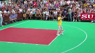 KIEV, UKRAINE, AUGUST 24, 2012: Dancer in yellow shirt. Final Ukrainian streetball league on Khreschatyk street dedicated to celebrating Independence Day in Kiev, Ukraine, August 24, 2012