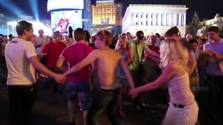 KIEV, UKRAINE, AUGUST 24, 2012: Dancing youth on holiday party on Independence Square dedicated to celebrating Independence Day in Kiev, Ukraine, August 24, 2012.