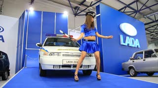 KIEV, UKRAINE, MAY 26, 2011: VAZ Lada 2110 and policewoman at yearly automotive-show