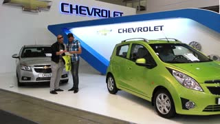 """KIEV, UKRAINE, MAY 27, 2012: Chevrolet Cruse and Chevrolet Spark at yearly automotive-show """"SIA 2011"""" in Kiev, Ukraine."""