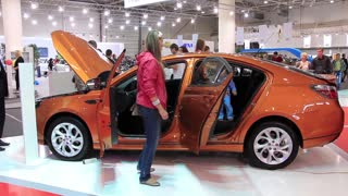 "KIEV, UKRAINE, MAY 27, 2012: People at yearly automotive-show ""SIA 2011"" in Kiev, Ukraine."