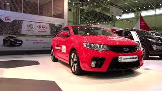 "KIEV, UKRAINE, MAY 27, 2012: Red KIA Cerato at yearly automotive-show ""SIA 2011"" in Kiev, Ukraine."