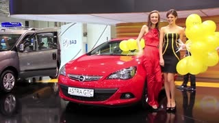 "KIEV, UKRAINE, MAY 27, 2012: Red Opel Astra GTC at yearly automotive-show ""SIA 2011"" in Kiev, Ukraine."