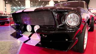 KIEV, UKRAINE, MAY 31, 2013: Black  Ford Mustang at yearly automotive-show in Kiev, Ukraine