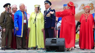 KIEV, UKRAINE, MAY 9, 2012: Holiday concert dedicated to the 67th Anniversary of victory in Great Patriotic War. Elderly men in military uniform and women sing a song, Kiev, Ukraine, May 9, 2012