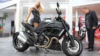 "KIEV, UKRAINE - SEPTEMBER 11: Black Dukati motorcycle at yearly automotive-show ""Capital auto show 2011"". September 11, 2011 in Kiev, Ukraine."