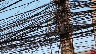 Large number of electrical wires on electric post