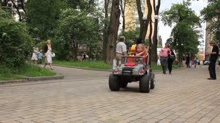 Little boy drive a toy car