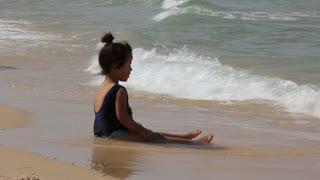 Little girl on seashore