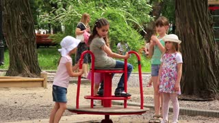 Little girls on childrens playground