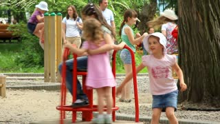 Little girls on the merry-go-round. Little girls on childrens playground. Timelapse 1080p