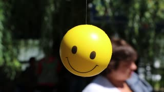 Little yellow ball with smile
