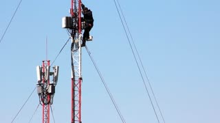Maintenance personnel on cellular antenna. Steeplejack - is a master who scales buildings, chimneys and church steeples to carry out repairs or maintenance