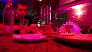 Man drinking in a restaurant