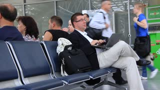 Man in airport with laptop