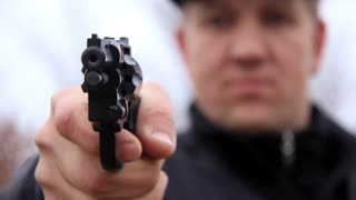 Man shooting with revolver