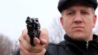 Man shoots from revolver