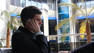 Man speaks on a mobile phone