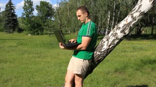Man with notebook on the nature